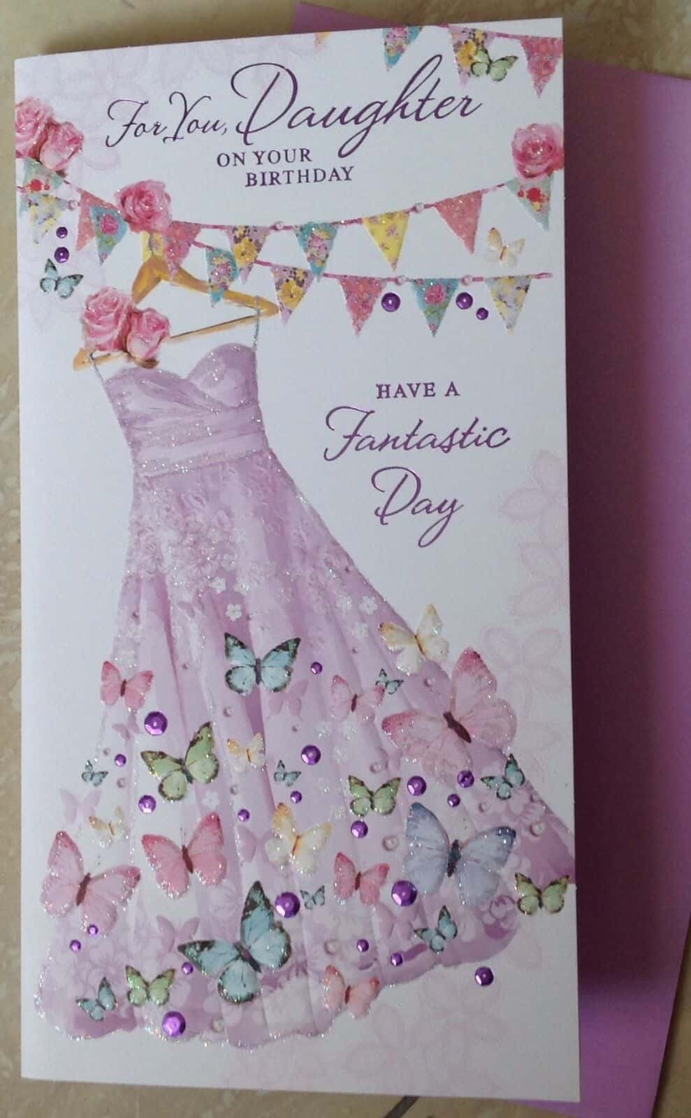 Daughter Birthday Card With Embossed Dress And Butterfly Design